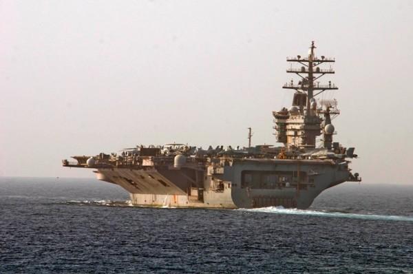 USS Dwight D. Eisenhower (CVN 69) steams forward as the carrier transits the Strait of Hormuz.