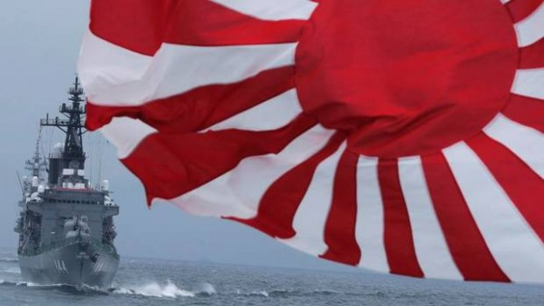 JMSDF escort ship Kurama, left, navigates behind destroyer Yudachi with a flag, during a fleet review in water off Sagami Bay