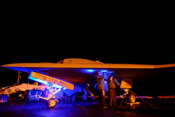 X-47B Unmanned Combat Air System (UCAS) demonstrator taxies on the flight deck of the aircraft carrier USS Harry S. Truman (CVN 75).