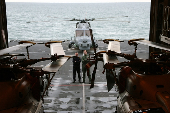 Cdr Adrian Fryer (left), HMS Dauntless' Commanding Officer, and Cdr Anthony Rimington, Commanding Officer of 702 Naval Air Squadron