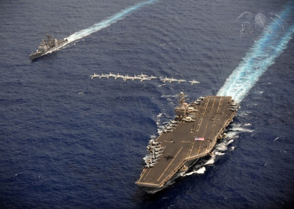 FA-18 Hornets and Super Hornets conduct an air power demonstration over the USS Abraham Lincoln (CVN 72