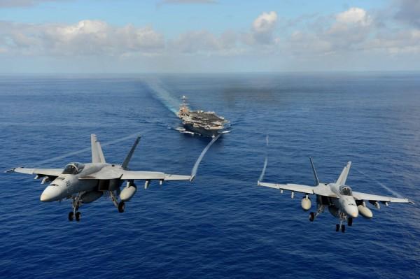 Two FA-18E Super Hornets participate in an air power demonstration over USS John C. Stennis (CVN 74).