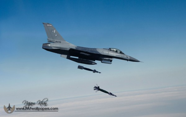 A F-16 dropping two 500lbs GBU-12 Laser Guided Bombs (LGB)