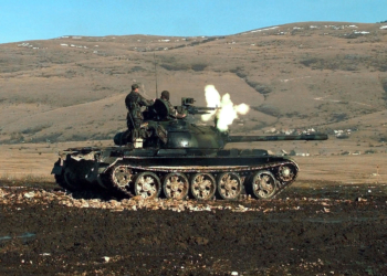 Members of the Croatian Defense Council (HVO) Army, 2nd Guard Brigade, fire the 12.7mm machine gun, mounted on a T-55 main battle tank during a three-day exercise when the HVO Army was granted use of Barbara Range for the first time in 18 months.  (Duplicate image, see also DD-SD-01-05146  or search 980110-F-7866P-502)