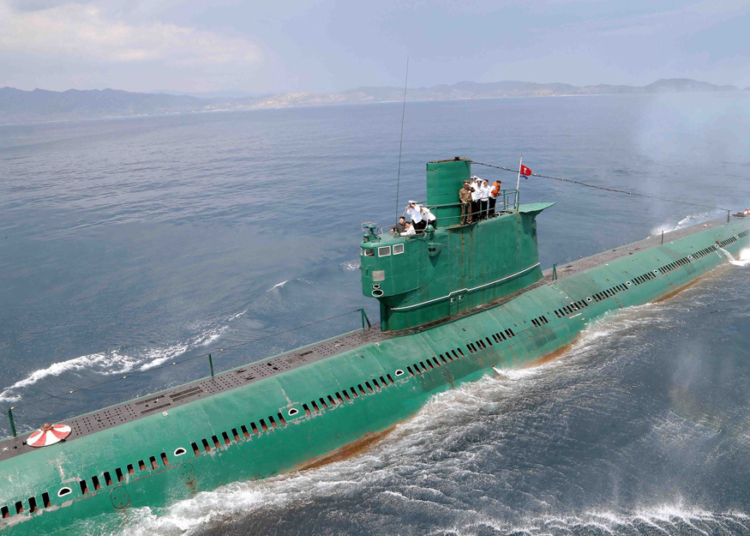 "This undated picture released from North Korea's official Korean Central News Agency (KCNA) on June 16, 2014 shows North Korean leader Kim Jong-Un (L in black) inspecting the submarine No. 748 of Korean People's Army (KPA) naval unit 167 led 7th regiment at an undisclosed location in North Korea. AFP PHOTO / KCNA via KNS    REPUBLIC OF KOREA OUT --- THIS PICTURE WAS MADE AVAILABLE BY A THIRD PARTY. AFP CAN NOT INDEPENDENTLY VERIFY THE AUTHENTICITY, LOCATION, DATE AND CONTENT OF THIS IMAGE. THIS PHOTO IS DISTRIBUTED EXACTLY AS RECEIVED BY AFP. ---EDITORS NOTE--- RESTRICTED TO EDITORIAL USE - MANDATORY CREDIT ""AFP PHOTO / KCNA VIA KNS"" - NO MARKETING NO ADVERTISING CAMPAIGNS - DISTRIBUTED AS A SERVICE TO CLIENTSKNS/AFP/Getty Images"