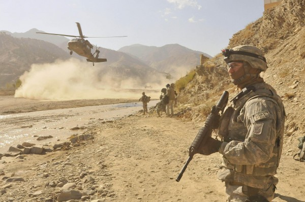 091116-F-9351O-110        U.S. Navy Petty Officer 3rd Class Anthony Constantinidis, a medic with the Khost Provincial Reconstruction Team, secures a landing zone for a UH-60 Black Hawk helicopter during an air assault extraction in Spera, Afghanistan, on Nov. 16, 2009.  Members of the Khost Provincial Reconstruction Team visited the district governor to assess progress being made in the area.  DoD photo by Staff Sgt. Stephen J. Otero, U.S. Air Force.  (Released)