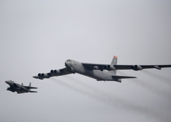 A U.S. Air Force B-52 (R) flies over Osan Air Base in Pyeongtaek, South Korea, January 10, 2016. REUTERS/Kim Hong-Ji TPX IMAGES OF THE DAY