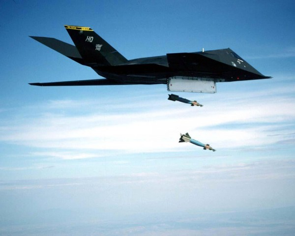 F-117A Nighthawk,Aircraft, Fighter, Photo by TSgt Marvin Lynchard. Primary Function:  Fighter, Bomber.  Contractor:  Lockheed Aeronautical Systems Co. Speed:  High Subsonic. Dimensions:  Wingspan 43 ft. 4 in., length 65 ft. 11 in., height 12 ft. 5 in.  Range:  Unlimited with air refueling.  Armament:  Internal weapons carriage able to employ a variety of weapons.  Crew:  pilot only