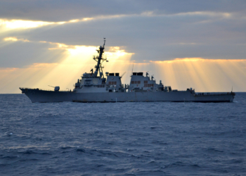 PHILIPPINE SEA (Feb. 01, 2012) - Guided-missile destroyer USS Curtis Wilbur (DDG 54) waits for a passenger transfer amidst the sunrise in the Philippine Sea. Curtis Wilbur is forward-deployed to Yokosuka, Japan. (U.S. Navy Photo by Ensign Jimmy Stokes)