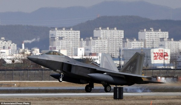 One of four U.S. F-22 stealth fighter lands at Osan Air Base in Pyeongtaek, South Korea, Wednesday, Feb. 17, 2016. Four U.S. F-22 stealth fighters flew over South Korea on Wednesday in a clear show of power against North Korea, a day after South Korea's president warned of the North's collapse amid a festering standoff over its nuclear and missile ambitions. (AP Photo/Lee Jin-man)