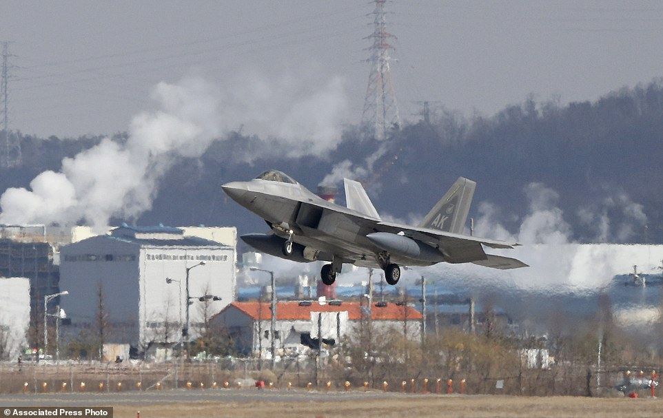 One of four U.S. F-22 stealth fighters prepares to land at Osan Air Base in Pyeongtaek, South Korea, Wednesday, Feb. 17, 2016. Four U.S. F-22 stealth fighters flew over South Korea on Wednesday in a clear show of power against North Korea, a day after South Korea's president warned of the North's collapse amid a festering standoff over its nuclear and missile ambitions. (AP Photo/Lee Jin-man)