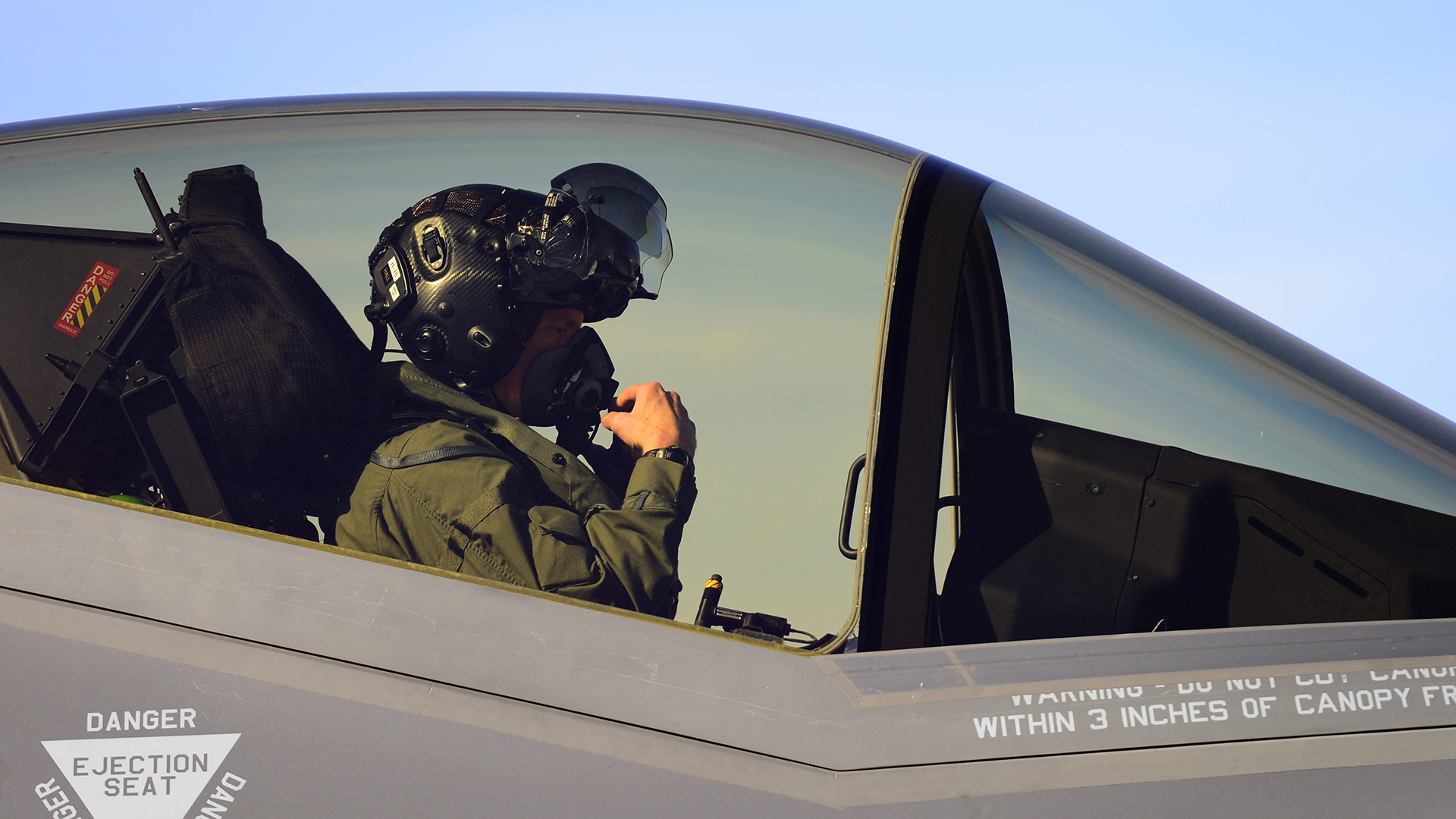 U.S. Air Force Major Kevin Hall goes through his pre-flight checks before flying an F-35A at Hill Air Force Base, Utah. Hall is an F-35 test pilot. (U.S. Air Force photo by Airman 1st Class Joshua D. King/ RELEASED)