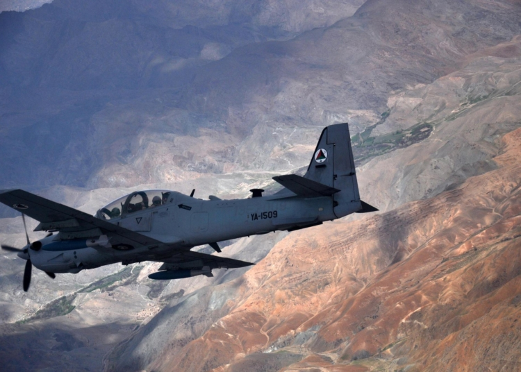 An A-29 Super Tucano flies over Afghanistan during a training mission April 6, 2016. The A-29 is a light attack aircraft that can be armed with two 500-pound bombs, twin .50-caliber machine guns and rockets. Aircrews are trained on aerial interdiction and armed overwatch missions that enable a preplanned strike capability. The Afghan air force currently has eight A-29s but will have 20 by the end of 2018. Train, Advise, Assist Command-Air teams work daily with the Afghan air force to help build a professional, sustainable and capable air force. (U.S. Air Force photo/Capt. Eydie Sakura)