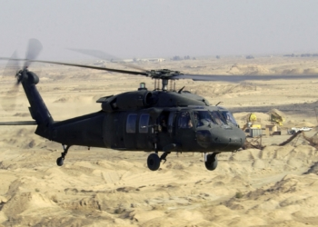 A US Army (USA) UH-60L Black hawk Helicopter flies a low-level mission over Iraq during Operation IRAQI FREEDOM.