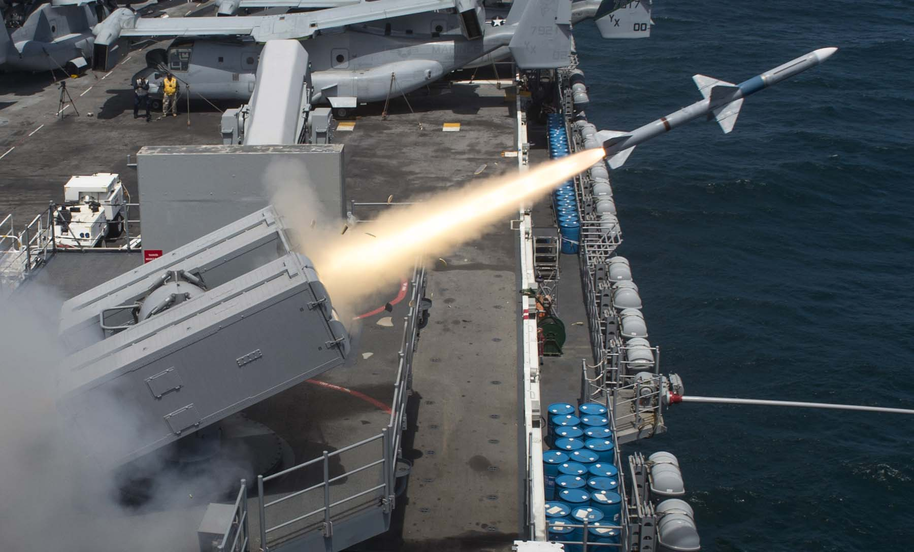 130718-N-JP249-022  PACIFIC OCEAN (July 18, 2013) A Sea Sparrow (RIM-7P) missile is launched from the amphibious assault ship USS Boxer (LHD 4) during a missile firing exercise. Boxer is underway off the coast of Southern California conducting a composite training unit exercise (COMPTUEX). COMPTUEX is a scenario-driven exercise aimed at integrating the ships of the Boxer Amphibious Ready Group through a series of live training events. (U.S. Navy photo by Mass Communications Specialist 2nd Class Kenan O'Connor/Released)