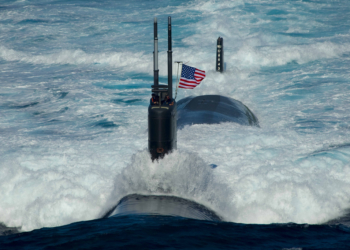 "100726-6720T-N-246 EAST SEA (July 26, 2010) The Los Angeles-class attack submarine USS Tuscon (SSN 770) transits the East Sea while leading a 13-ship formation. The Republic of Korea and the United States are conducting the combined alliance maritime and air readiness exercise ""Invincible Spirit"" in the seas east of the Korean peninsula from July 25-28, 2010. This is the first in a series of joint military exercises that will occur over the coming months in the East and West Seas. (U.S. Navy photo by Mass Communication Specialist 3rd Class Adam K. Thomas/Released)"